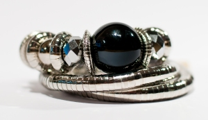 New curved one piece 'snake' bracelet with black ball only £7.95